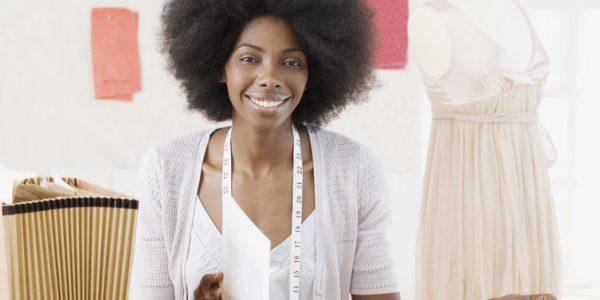 African seamstress in design workshop